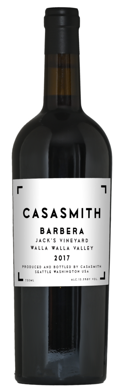 A tall dark Italian style bottle of wine. Black capsule on top and white label with black text that reads: CasaSmith Cinghiale Sangiovese, Wahluke Slope & Rosebud Vineyards.