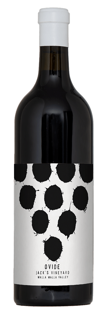 A luxurious dark bottle of wine with white capsule and white label with black text.